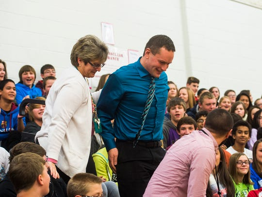 New Oxford Middle School teacher Anthony Angelini steps