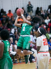 Janay Outten of Fort Myers goes up for a shot on Friday,