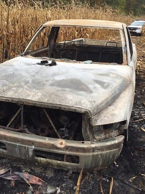 Truck recovered by Gibsonburg police that caught fire in a cornfield after chase.