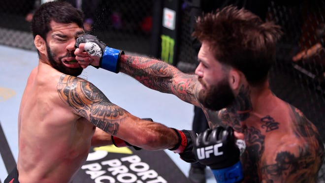 "Former UFC bantamweight champion Cody ""No Love"" Garbrandt snapped a three-fight losing streak in devastating fashion, knocking out Raphael Assuncao in the second round in the co-main event of UFC 250 in Las Vegas Saturday night. Photo courtesy of UFC"