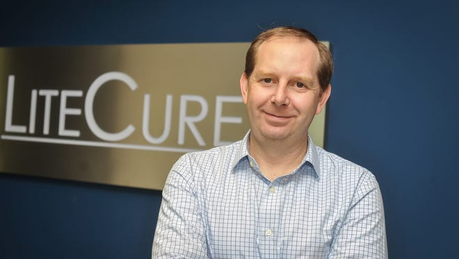 Brian Pryor, CEO of LiteCure, is seen at the company's office in the Pencader Corporate Center near Glasgow.