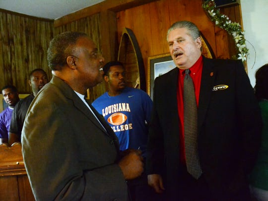 City of Alexandria councilman Roosevelt Johnson (left) talks with LHSAA executive director Eddie Bonine at Tunk's Cypress Inn in 2015. Bonine discussed the possibility of Alexandria hosting future LHSAA events such as the Great 48 — the girls and boys state basketball tournaments.