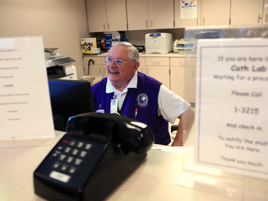 Richard Peters, 75, a volunteer in the catheterization lab at Christus Spohn Hospital Shoreline, checks the patient list on Wednesday, Aug. 2, 2017. He has been a volunteer at the hospital for 13 years and helps train new volunteers.