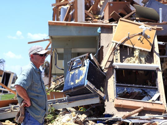 Kim Weatherford surveys the damage at his vacation home in Copano Cove in Rockport, TX on August 30, 2017. The home sustained major damage from Hurricane Harvey.(Rachel Denny Clow/Corpus Christi Caller-Times, via AP)
