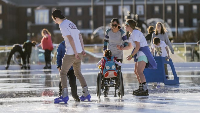 Special needs guests, family, and caretakers skate around The Ice at Center Green skating rink during a special needs afternoon skating session in Carmel Ind. on Monday, Feb. 26, 2018.