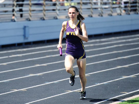 Wylie's Abbey Henson runs the third leg of the girls
