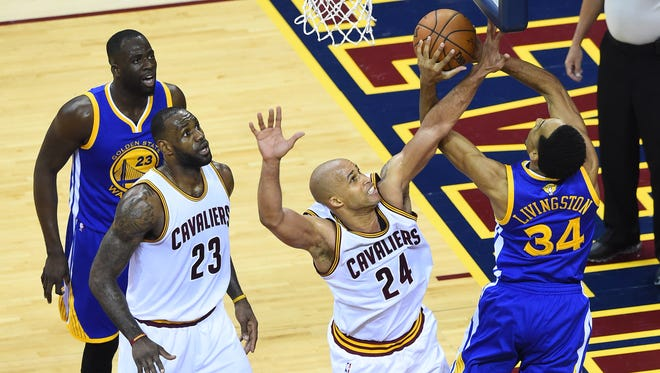 Golden State Warriors guard Shaun Livingston (34) shoots the ball as Cleveland Cavaliers forward Richard Jefferson (24) defends during the first quarter in game four of the NBA Finals at Quicken Loans Arena.
