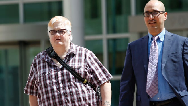 FILE - In this July 20, 2016, file photo, Dana Zzyym, of Fort Collins, Colo., left, and Paul D. Castillo, staff attorney of the South Central regional office of Lambda Legal, emerge after a hearing on Zzyym's lawsuit in Denver. Zzyym, who was born with ambiguous sex characteristics, claims that requiring people to designate their sex to get a passport is discriminatory. On Tuesday, Nov. 22, the district court ruled that the U.S. State Department violated federal law when it denied a passport to Zzyym, who is intersex, because Zzyym could not accurately choose either male or female on the application form.