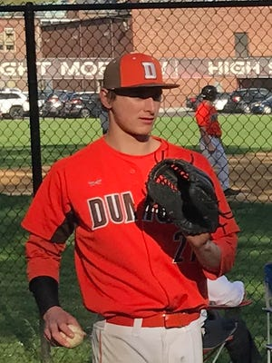Dumont pitcher Daniel Raglievich stays loose while his team bats in Tuesday's win at Dwight Morrow. The senior threw a five-hit shutout to help the Huskies clinch the Big North American title.