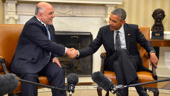 President Obama shakes hands with Iraqi Prime Minister Haider al-Abadi after a bilateral meeting in the Oval Office of the White House on April 14, 2015.