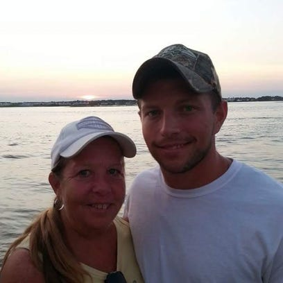 Kyle Brittingham, right, is shown with his mom, Patti