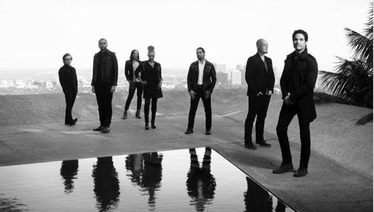 """The members of Train, from left: Jerry Becker, Drew Shoals, Nikita Houston, Sakai Smith, Hector Maldonado, Jimmy Stafford and Pat Monahan. The group has a new video for """"Give It All"""" and a tour starting May 21."""