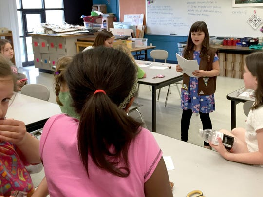 Sarah Shamus, 8, presents her idea to Girl Scout Troop 71315 for a Kids Fun Run for Paws to benefit the Grosse Ile Animal Shelter.