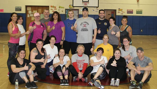 Participants in the Dover Plains Running Club's winter workout pose together on Friday.