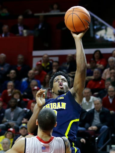 Michigan guard Derrick Walton Jr. (10) takes a shot