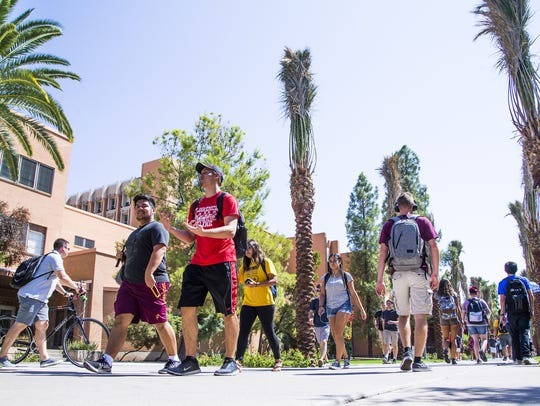 Arizona State University students take Palm Walk between