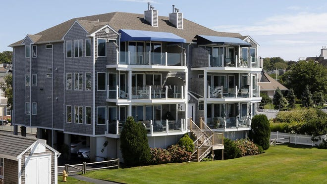 David Hurd's condo is on the second level, on the right, of this oceanfront property in Newport. Hurd is trying to sell it for $1.2 million. Cynthia Dziurgot had a lease to live there from November to April, but she has refused to leave, citing the coronavirus pandemic.