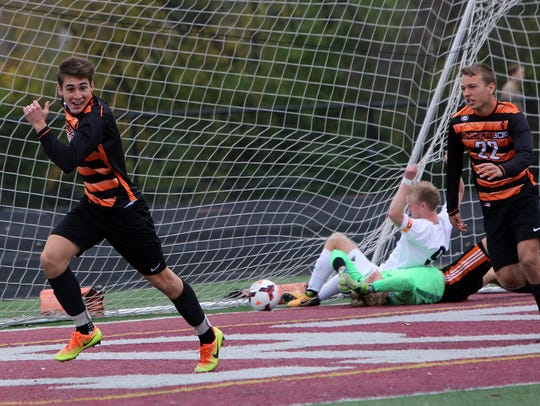 Anderson's Brevin Andreadis reacts after scoring a