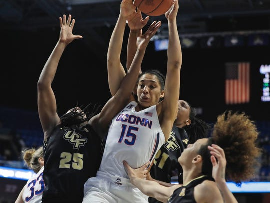 Connecticut guard Gabby Williams grabs a rebound against