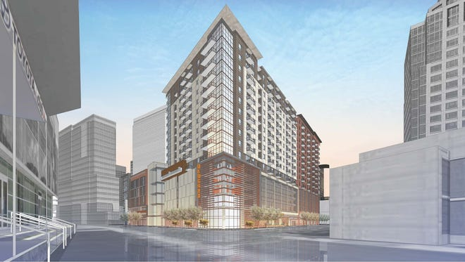 "An artist's rendering of the Block 23 development shows a project that would include about 300 apartment units, streetscape improvements and 50,000 square feet of commercial space, including the grocery store. High-rise towers would feature 150,000 square feet of ""creative, open office space"" and 1,000 parking stalls."