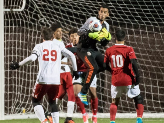 Coldwater's Balal Nasser makes a save during first-half action against Holland in the District 2 semifinal Wednesday evening.