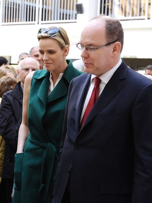 Princess Charlene of Monaco (L) and Prince Albert II (R) of Monaco visit Aurillac, central France, on May 14, 2014, during a state visit to the French central Cantal region.