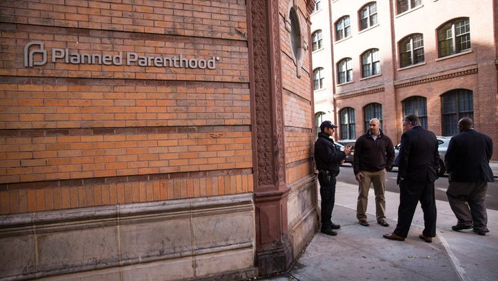 A police officer stands guard outside Planned Parenthood