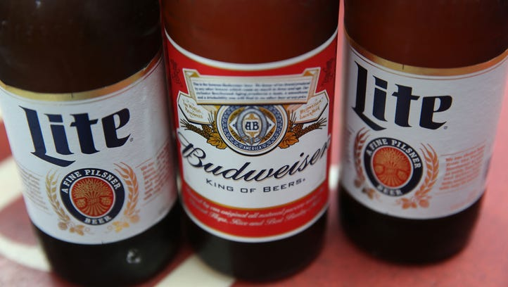 In this photo illustration, bottles of Budweiser and