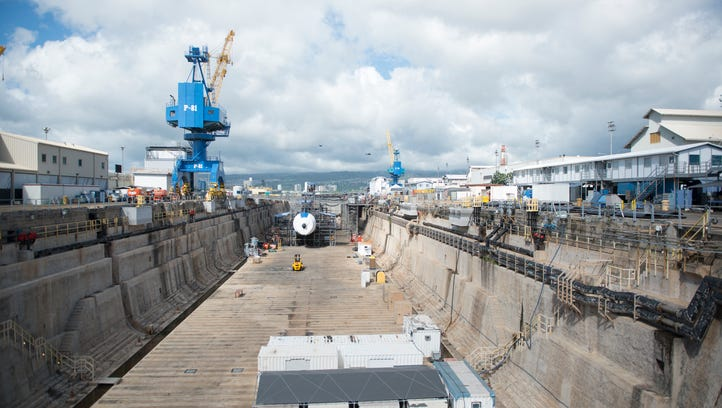A nuclear attack submarine occupies the forward section of the dry dock.   December 7, 2016, will mark the 75th anniversary of the Japanese attack on Pearl Harbor that brought the U.S. into WWII.  --    Photo by Jasper Colt, USA TODAY staff ORG XMIT:  JC 135352 Hawaii memorials 9/28/2016 [Via MerlinFTP Drop]