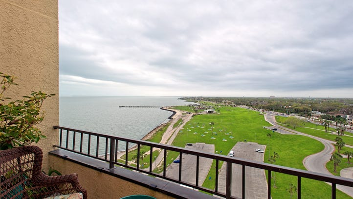 The view from the living area balcony takes in bay,
