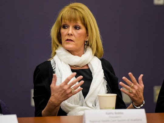 Kathy Bobbs, president of the Regional Health Care System of Acadiana, speaks with fellow area business professionals during a discussion at the Daily Advertiser in Lafayette, La., Tuesday, Jan. 13, 2015.