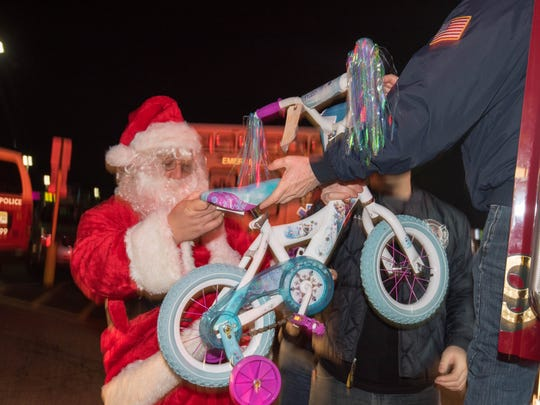 RAINE Foundation volunteers gather toys and bicycles