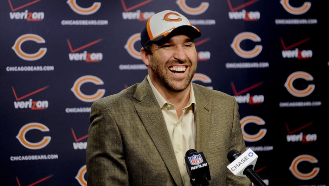New Chicago Bears NFL football player Jared Allen, laughs while he talked to the media at a news conference where Allen was introduced Monday, March 31, 2014, in Lake Forest, Ill.