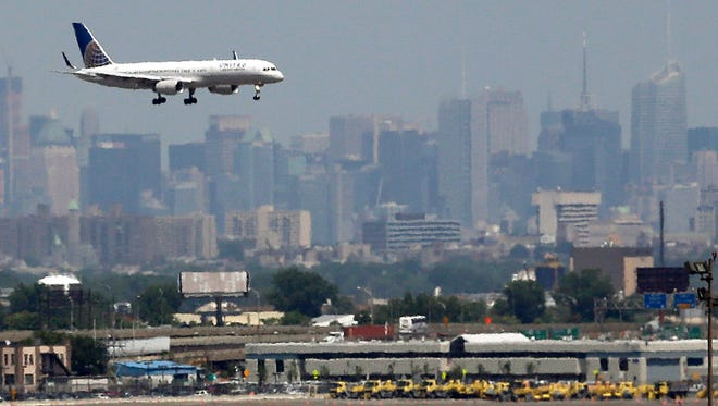 This file photo from July 10, 2012, shows a plane preparing to land at the Newark Liberty International Airport.