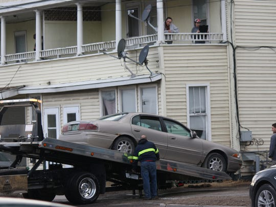 A car is removed from 89 First Street in Swanton Village