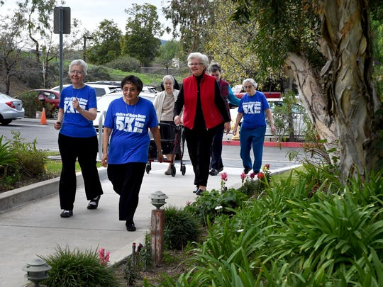 Regina Robbins, Julie Marie Arriaga, Francelia Klingshirn, Karlynn Werth, Antoinette Moon and Therese Kirstein, of the Sisters of Norte Dame convent in Thousand Oaks, go for a short walk before the event in 2015.