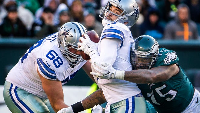 Cowboys quarterback Mark Sanchez is hit by Eagles defensive lineman Vinny Curry in the third quarter of the Philadelphia Eagles 27-13 win over the Dallas Cowboys at Lincoln Financial Field in Philadelphia, Pa. on Sunday afternoon.
