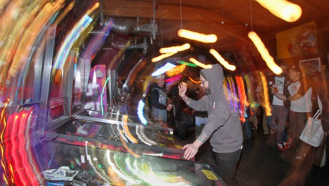 Eric Csakany practices his game during a break in the competition at Another Castle Arcade in Bremerton. You will find all the bells and whistles as well as lights and action during local pinball competitions.