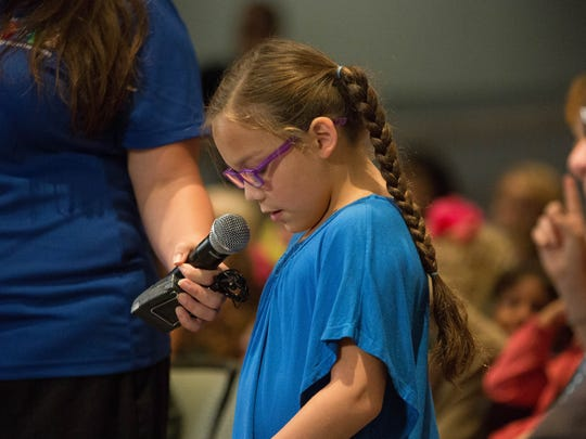 Sophia Hill, 10, a student at Central Elementary, reading from a note card, asks astronaut Ricky Arnold what it feels like in microgravity, during a NASA Downlink presentation at Las Cruces City Hall, Tuesday July 31, 2018.