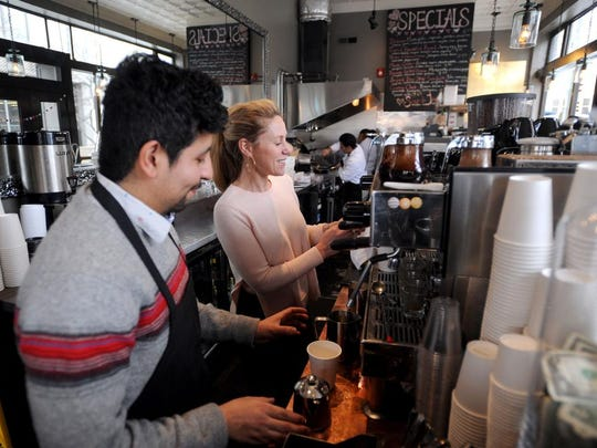 Jonny Mora, left, and Aimee Diaz prepare coffee and espresso drinks at Bomba on Feb. 25. The restaurant is at the corner of Pack Square and Patton in downtown Asheville.