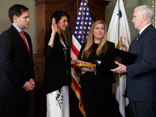 Vice President Mike Pence swears in Nikki Haley as U.S. ambassador to the United Nations. Washington, Jan. 25, 2017.
