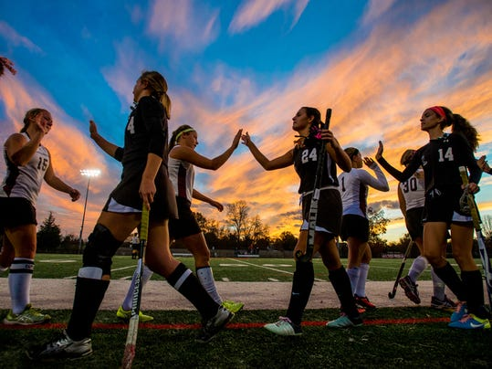Gettysburg players hold back tears while shaking hands with East Pennsboro after a 2-1 loss in the District 3 Class AAA field hockey tournament at Dover Area High School on Thursday.