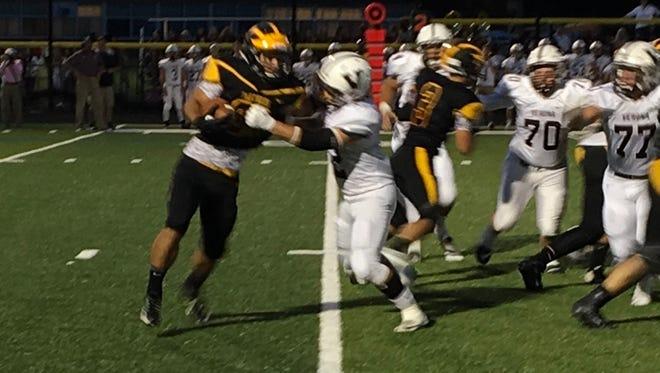 Cedar Grove running back Ryan Turi takes a handoff to the right against Verona.