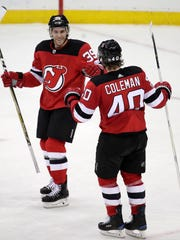 New Jersey Devils left wing Brian Gibbons, left, celebrates