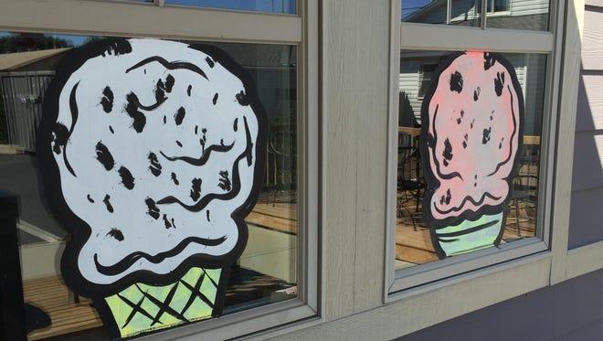 Ice cream cones decorate the outside of Fudgin Delicious.