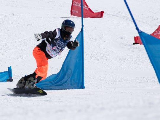 Shasta High's Sage Will races to a third-place finish in the junior women's snowboard slalom the Snowboard Nationals Tournament in Copper Mountain, Colorado.
