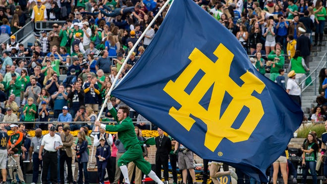 The Notre Dame Leprechaun runs with a Notre Dame flag after a touchdown in the first quarter of the game against the Miami Hurricanes at Notre Dame Stadium on Oct. 29, 2016.