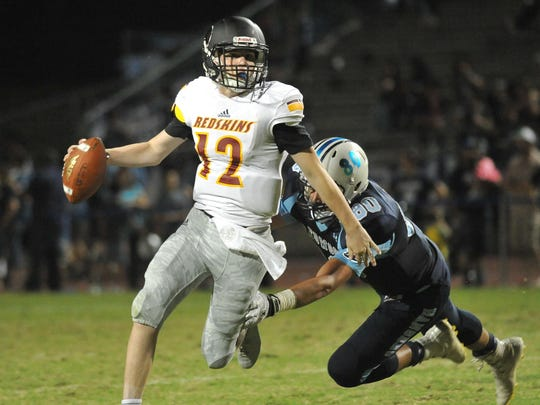 Tulare Union's Nathan Lamb avoids a tackle by Redwood's