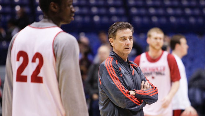 Louisville's Rick Pitino watches his team practice in Indianapolis at the NCAA Sweet 16 Thursday before Friday's Kentucky game. The Cardinals' practice was more physical than Kentucky's. March 27, 2014