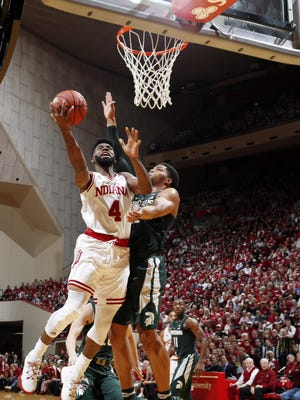 Indiana guard Robert Johnson (4) takes a shot against Michigan State's Miles Bridges on Saturday.